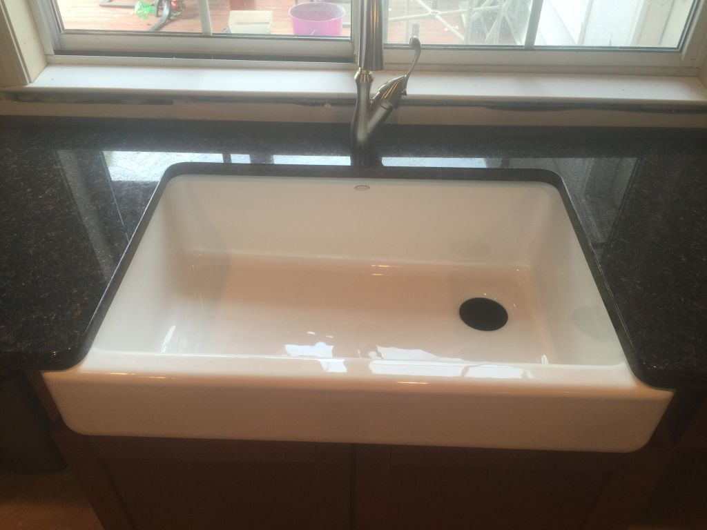 Granite Counter top with White Farm Sink .